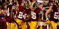 Redskins players discussing strategies