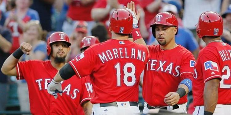 Texas Rangers' players giving high fives