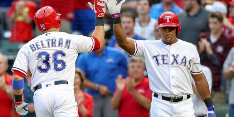 Texas Rangers teammates giving each other high fives