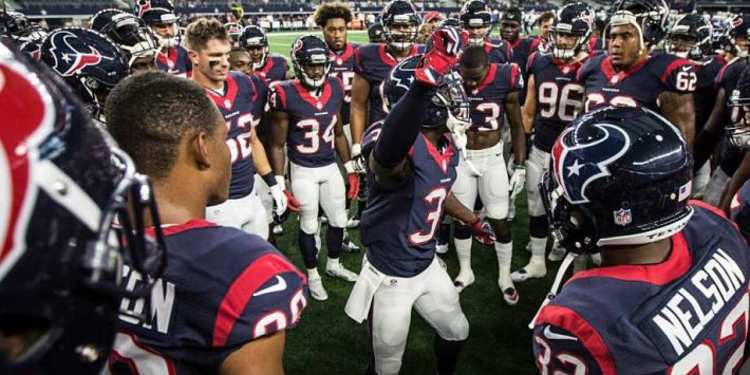 Houston Texans team gathered around