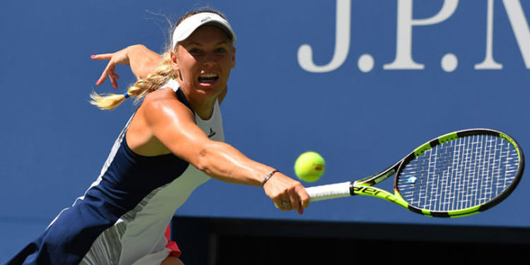 Caroline Wozniacki hitting a ball during a game