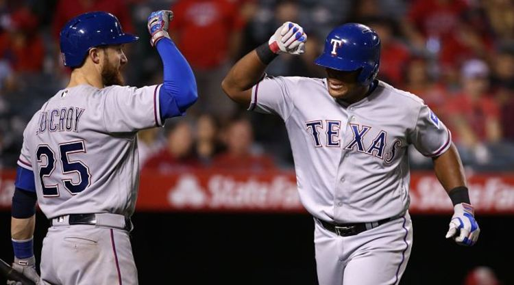 Texas Rangers players celebrate run