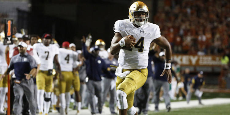 Notre Dame Player # 24 running with the ball during a game