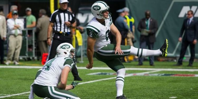 Jets teammate kicking ball