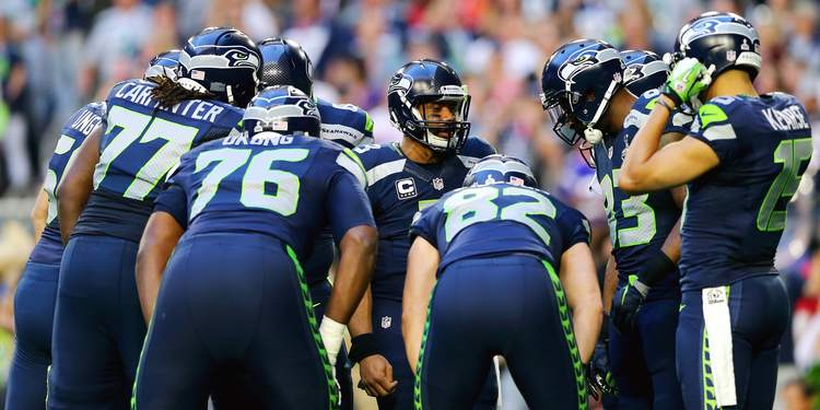 Seattle Seahawks team gathered around