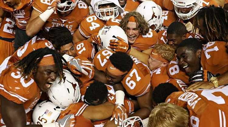 Pile of Texas Longhorns players