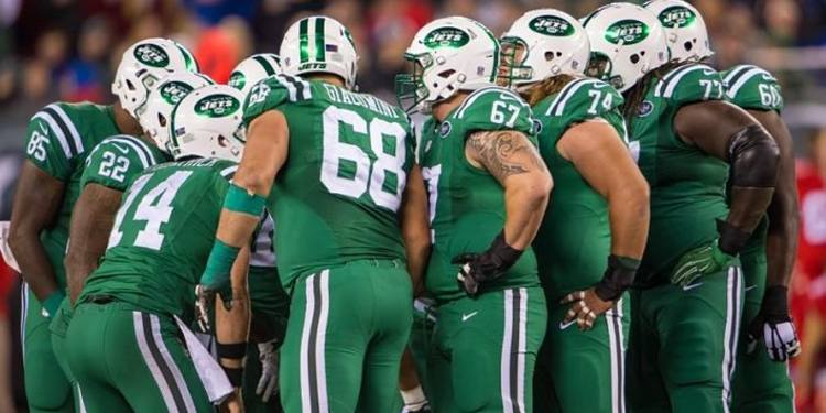 New York Jets team gathered around
