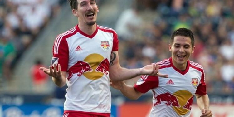 NY Red Bulls players celebrating during a game