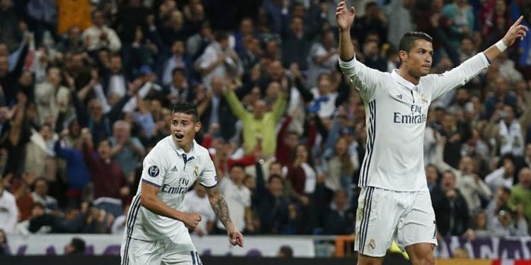 James Rodriguez and Cristiano Ronaldo during a game against Portugal celebrating CR7's goal