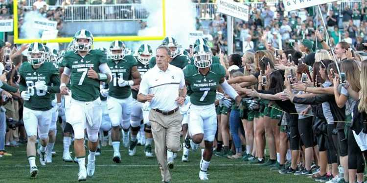 Michigan State Spartans running into the field