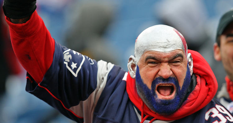 Patriots Fan Gearing A Jersey And With His Face Painted With Teams Colors