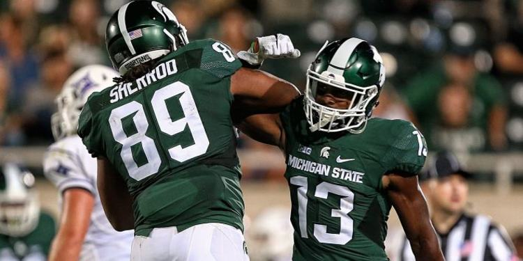 Michigan State Spartans players celebrating during a game