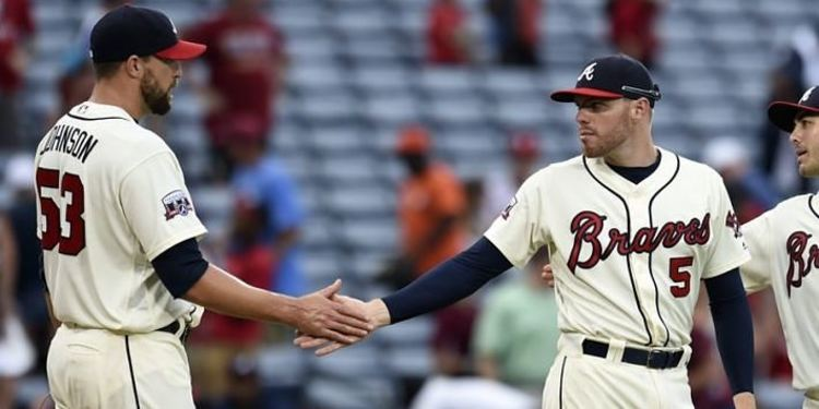 Atlanta Braves relief pitcher Jim Johnson (53) and first baseman Freddie Freeman (5) react after a game