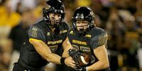 Southern Miss Golden Eagles players in action