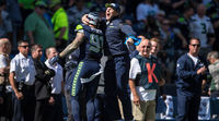 Seattle Seahawks Player Celebrates With Coach