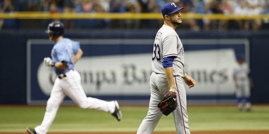Martin Perez Walking in the field during a game.