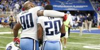 Tennessee Titans two players on the field hugging after a game