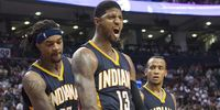 Paul George and his teammates celebrating during a game