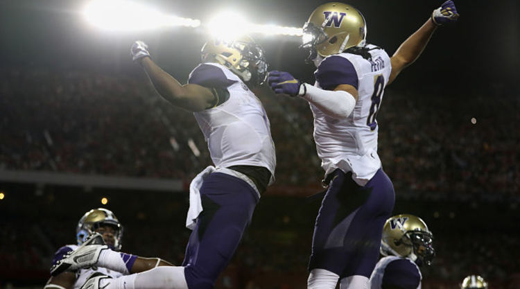 Washington Huskies Players Jump For Joy