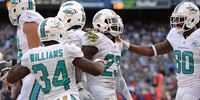 Miami Dolphins players celebrating