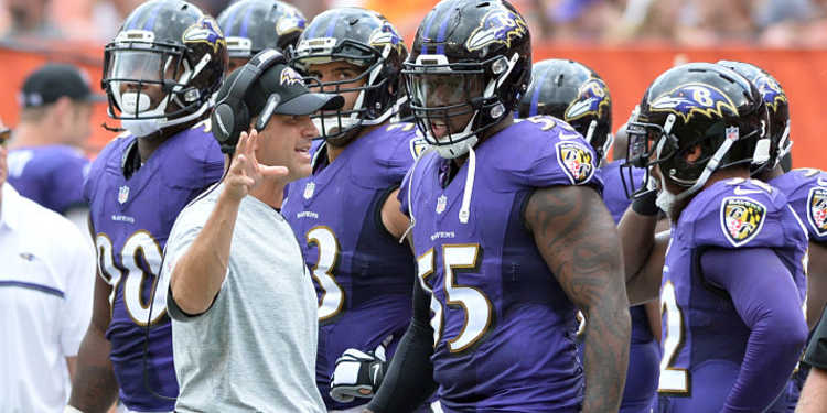 Baltimore Ravens players getting instructions from coach