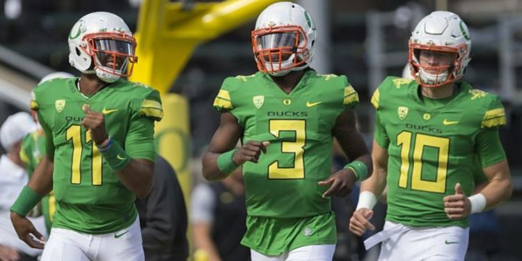 Oregon Ducks players in field