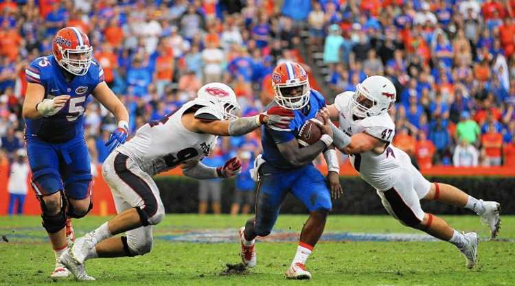 Florida Gators Player Tries To Escape Defenders