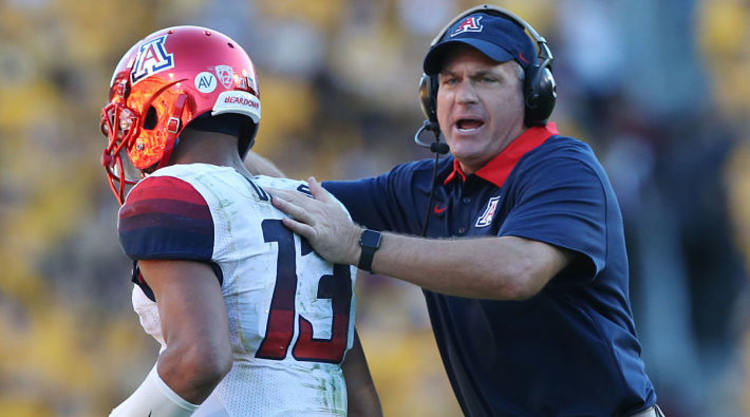 Arizona Wildcats Coach Congratulates Player