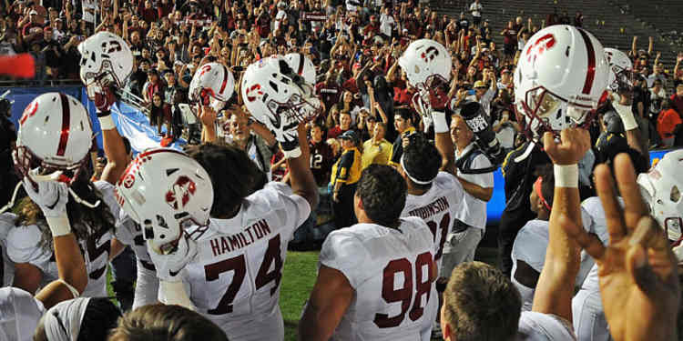 Stanford Cardinal  player greeting their fans