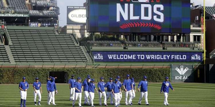 Chicago Cubs players walking on the field