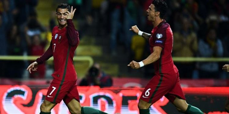 Portugal players celebrating after scoring a goal