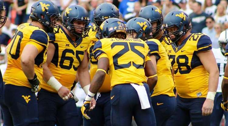 West Virginia Players In The Huddle