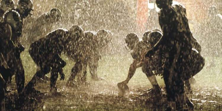 College Football Player playing in the rain