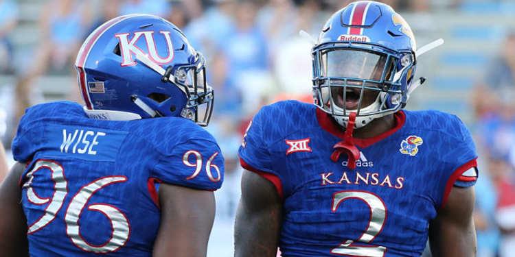 Kansas Jayhawks defensive end Dorance Armstrong Jr. and Kansas Jayhawks defensive tackle Daniel Wise