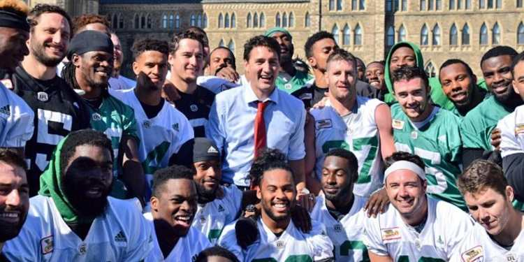 Roughriders snap picture with Trudeau during practice