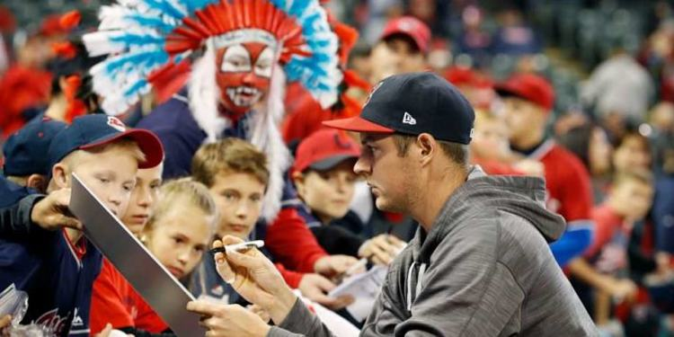 Cleveland Indians starting pitcher Trevor Bauer signs autographs for the kids