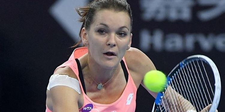 Agnieszka Radwanska of Poland hitting the ball