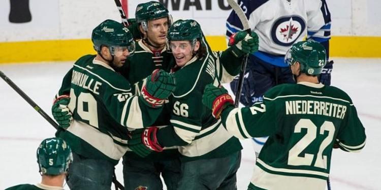 Minnesota Wild team celebrating with Jonas
