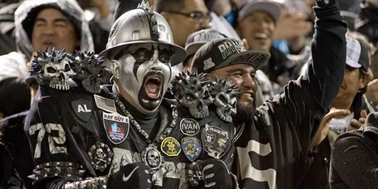 Oakland Raiders fan cheering for team
