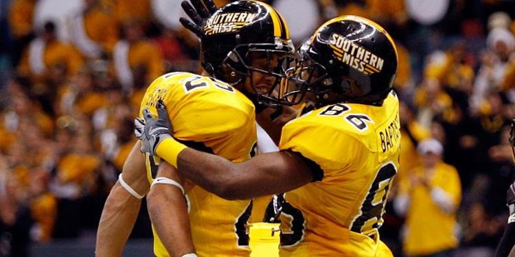 Southern Miss Golden Eagles Players embrace