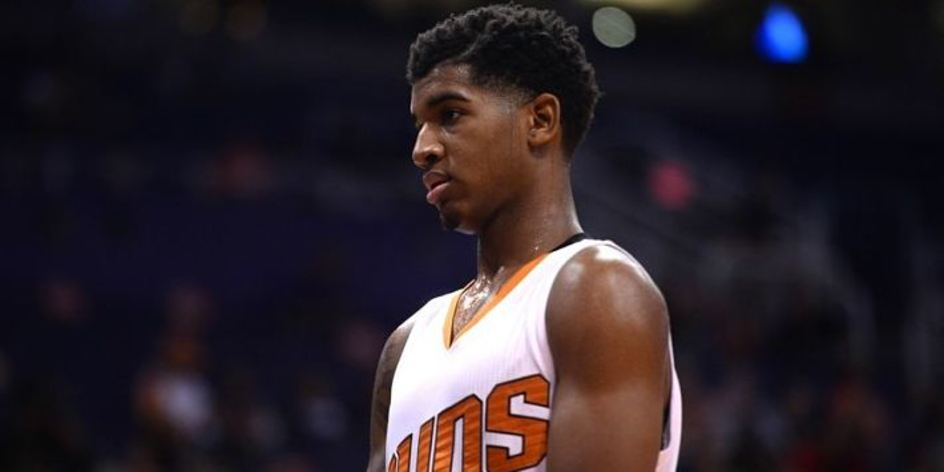 Marquese Chriss at a game with the suns caught off guard by the camera