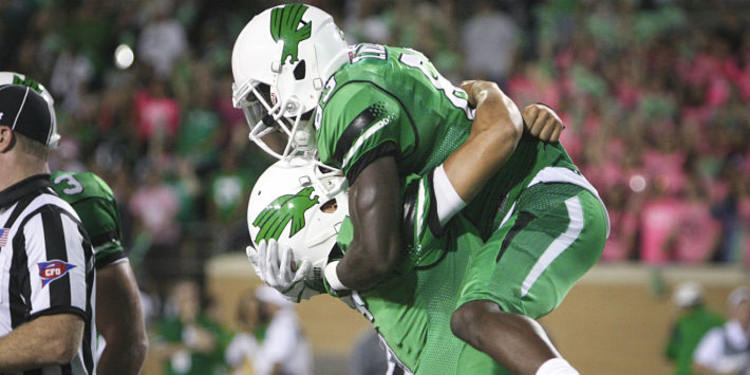 North Texas Mean Green Players Hug