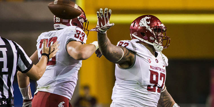 Washington State Cougars players in action
