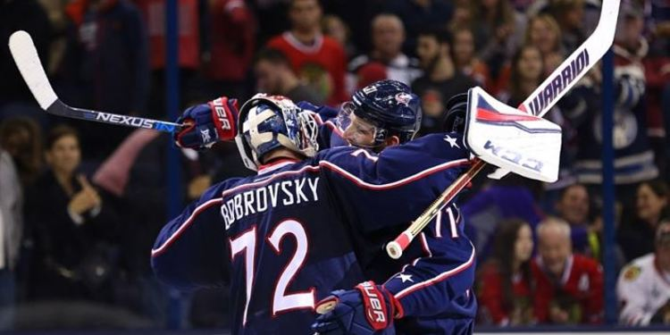 Columbus Blue Jackets players celebrating