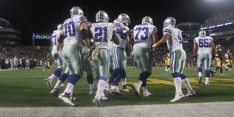 Dallas Cowboys players gathered around