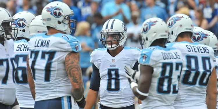 Tennessee Titans players gathered around