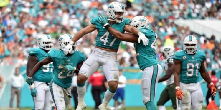 Miami Dolphins players celebrating