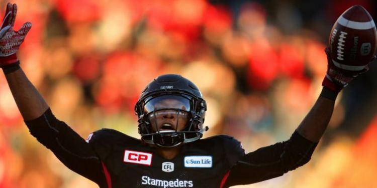 Calgary Stampeders number 88 player raising hands and holding a football
