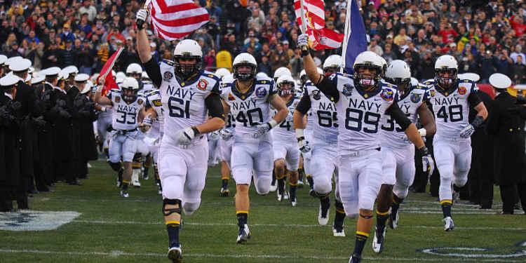 Navy Midshipmen Running The Field