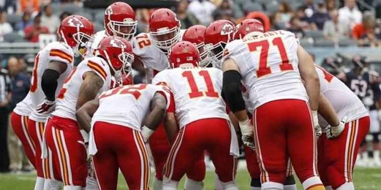 Kansas City Chiefs players gathered around